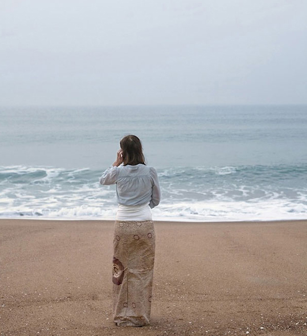 photo illusion - woman on beach
